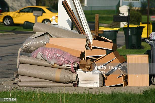 a pile of trash sitting on a curb - obsolete stock pictures, royalty-free photos & images