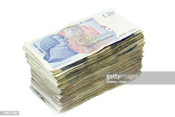 pile of twenty pound notes - british pound sterling note stock pictures, royalty-free photos & images