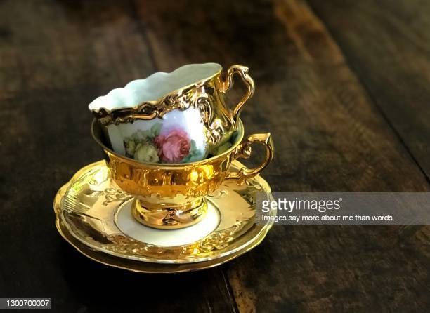a pile of two gorgeous tea cups in gold. still life. - royalty stock pictures, royalty-free photos & images