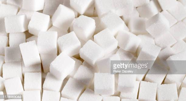 pile of unhealthy white sugar cubes - white stock pictures, royalty-free photos & images