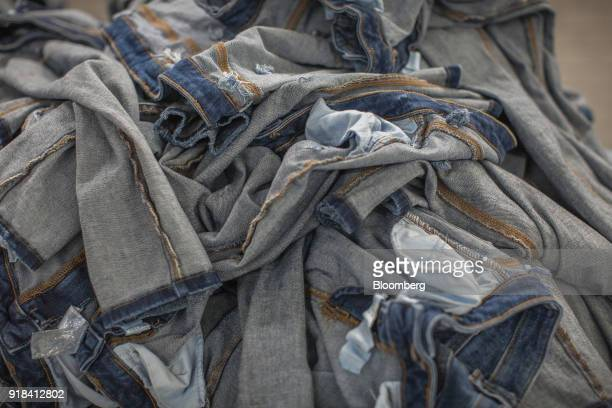 A pile of unwashed jeans sit in the washing unit of the Artistic Denim Mills Ltd factory in Karachi Pakistan on Tuesday Feb 6 2018 Pakistans...