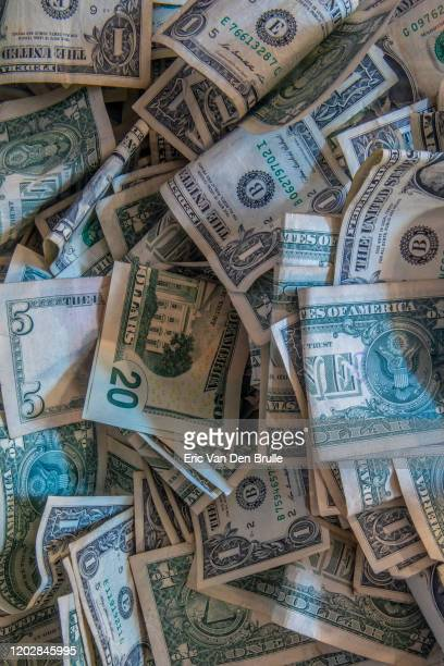 pile of us money - eric van den brulle stock pictures, royalty-free photos & images