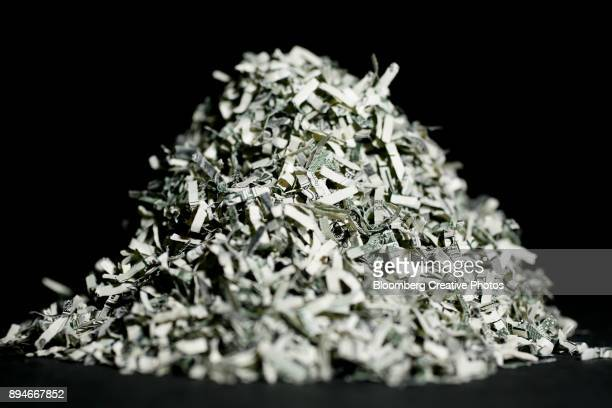a pile of u.s. shredded currency - money politics stock pictures, royalty-free photos & images