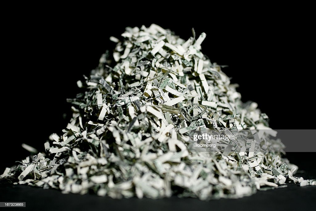 A pile of U.S. shredded currency valued at $150 is arranged for a photograph in Washington, D.C., U.S., on Wednesday, April 24, 2013. The S&P 500 has surged 134 percent from a 12-year low in 2009 as corporate earnings beat estimates and the Federal Reserve embarked on three rounds of bond purchases to stimulate the economy. Photographer: Andrew Harrer/Bloomberg via Getty Images