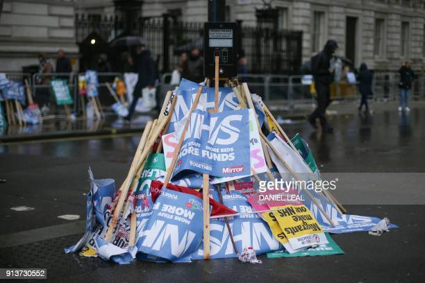A pile of used placards is seen outside Downing Street following a protest calling for an end to the 'crisis' in the staterun National Health Service...