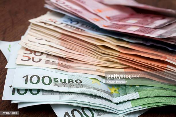 pile of various denomination euro notes