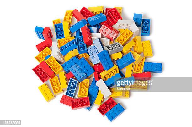 pile of vintage lego blocks from 1980s on white background - lego stock pictures, royalty-free photos & images