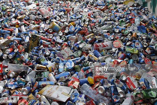 Pile of waste packaging, plastic bottles and tin cans