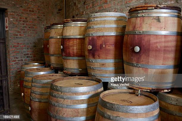 Pile of wooden barrels at winery