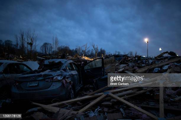 Piled debris surrounds foundations left after a tornado early Tuesday morning on March 4 2020 in Cookeville Tennessee A tornado passed through the...