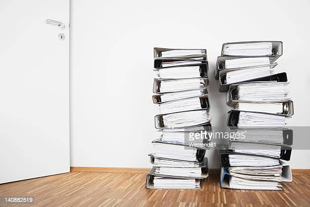 Piled of office files on parquet floor