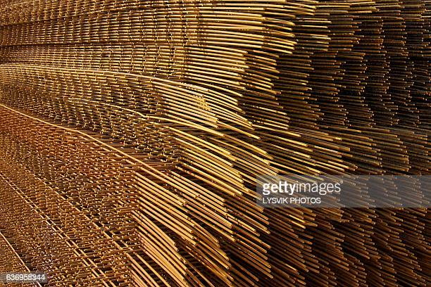 Piled, rusted iron plait mats for concrete work