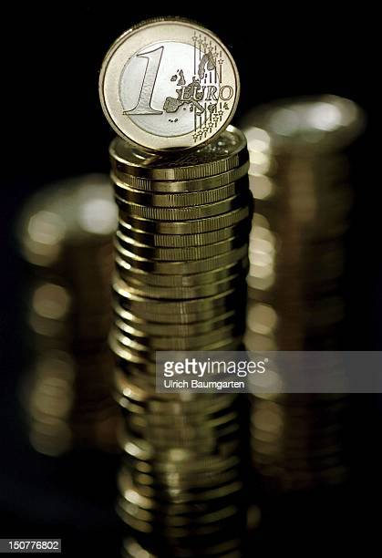 Piled up 1 Euro coins