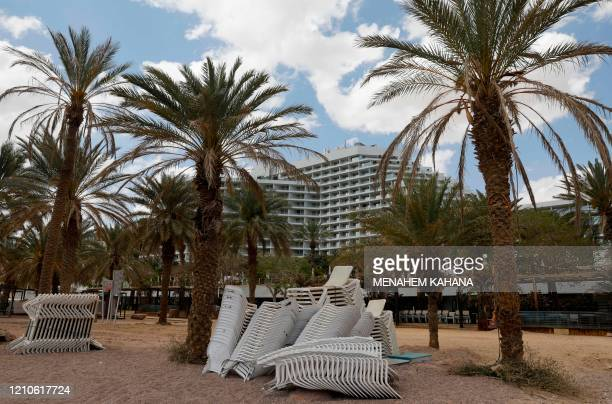 Piles of chairs are pictured at an empty Red Sea beach in the southern Israeli resort city of Eilat on April 17, 2020 amid the coronavirus COVID-19...