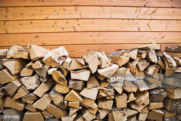 Piles of chopped wood outside house