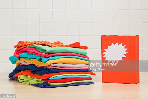 Piles of clean laundry and washing powder