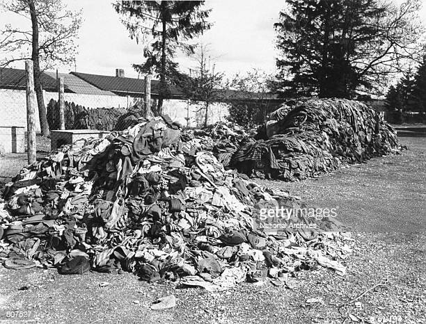 Piles of clothing that belonged to prisoners are seen at the Dachau concentration camp April 30, 1945 in Germany. Slave laborers were compelled to...