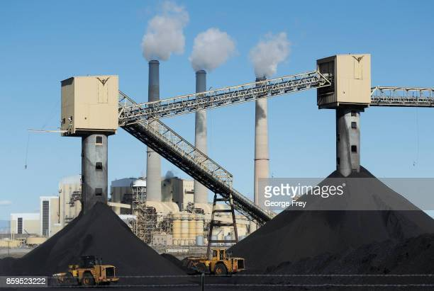 Piles of coal sit in front of Pacificorp's 1440 megawatt coal fired power plant on October 9 2017 in Castle Dale Utah It was announced today that the...