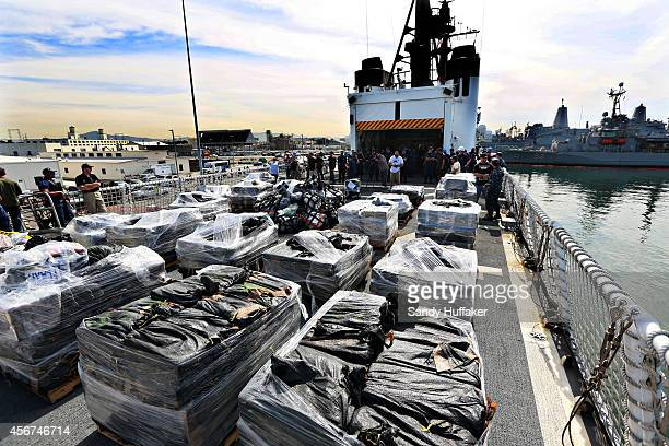 Piles of confiscated cocaine seized during a 18 different interdictions off the coast of Central and South America is prepared to be offloaded from...