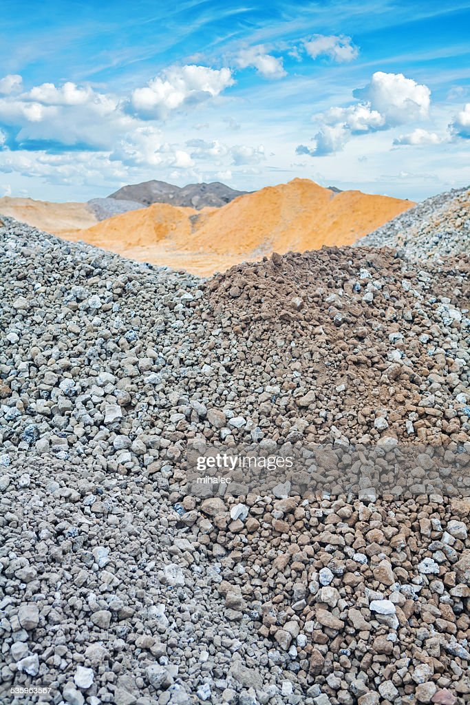 piles of construction sand and gravel on background the sky : Stock Photo