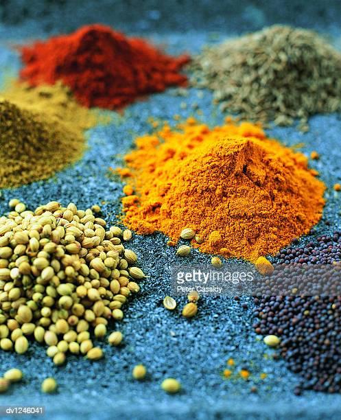 Piles of Coriander, Mustard, Paprika and Tumeric