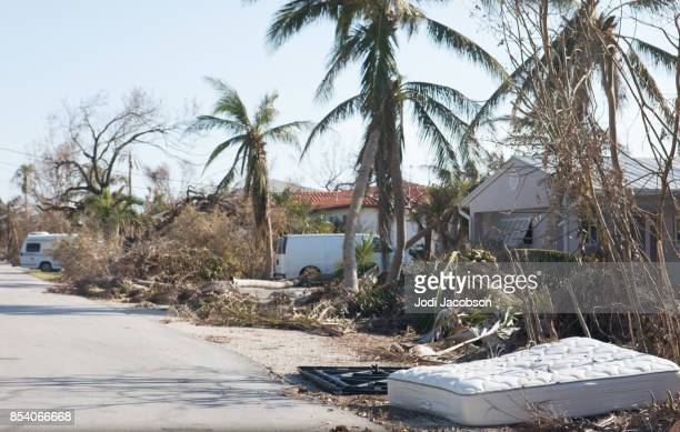 Piles of debris including bedding destroyed by flooding caused by hurricane.