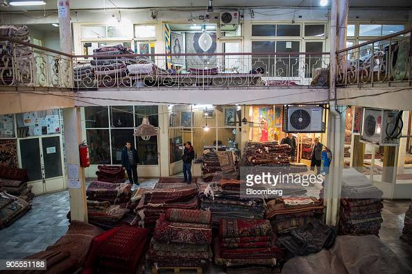 Piles Of Folded Persian Carpets Sit In