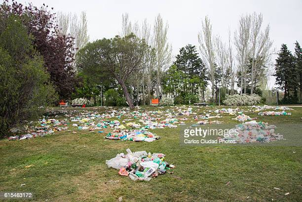 piles of garbage on a park after street drinking - cleaning after party stock pictures, royalty-free photos & images