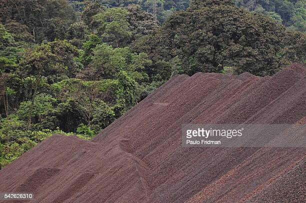 Piles of Iron Ore wait to be transported by train out of the Carajas mine owned by Companhia Vale do Rio Doce SA in the state of Para Brazil Vale...