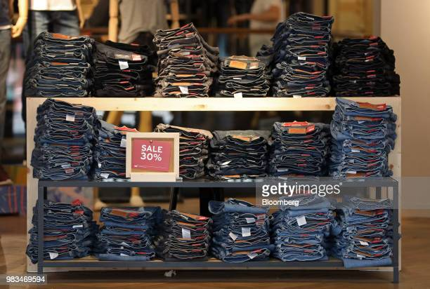Piles of jeans sit displayed for sale inside a Levi Strauss Co fashion store in London UK on Thursday June 21 2018 The rise of ecommerce which makes...