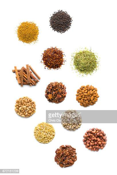piles of nuts and seasonings - pepper seasoning stock photos and pictures