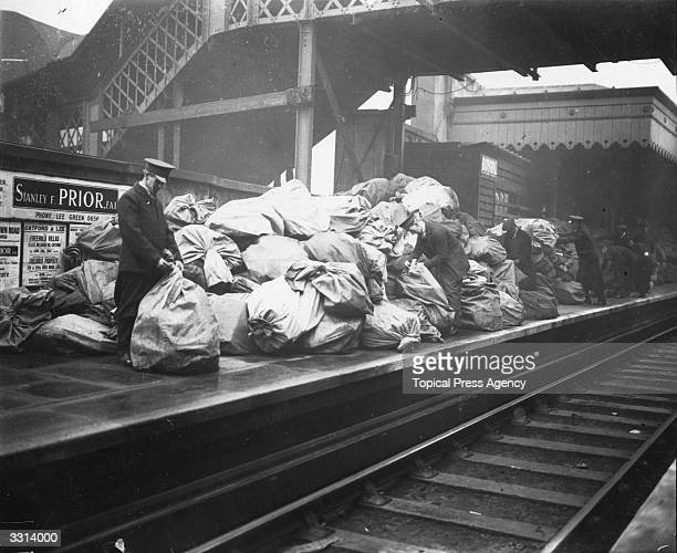 Piles of post bags on the platform of London Bridge Station where the Christmas rush overwhelmed the porters and sorters