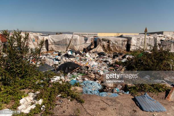 Piles of rubbish next to tents as police officers evict refugees from the shanty town of San Ferdinando on March 6 2019 in Reggio Calabria Italy The...
