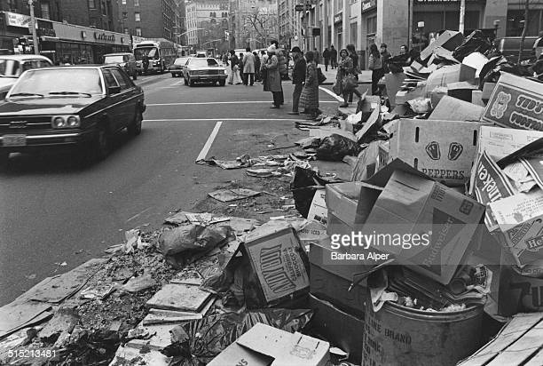 Piles of rubbish on a pavement during a seventeenday strike by garbage collectors in New York City December 1981