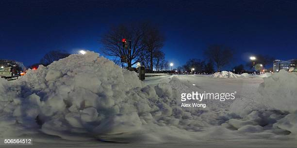 Piles of snow are seen in front of the US Capitol January 24 2016 in Washington DC The blizzard that has brought massive snowfall and a standstill to...