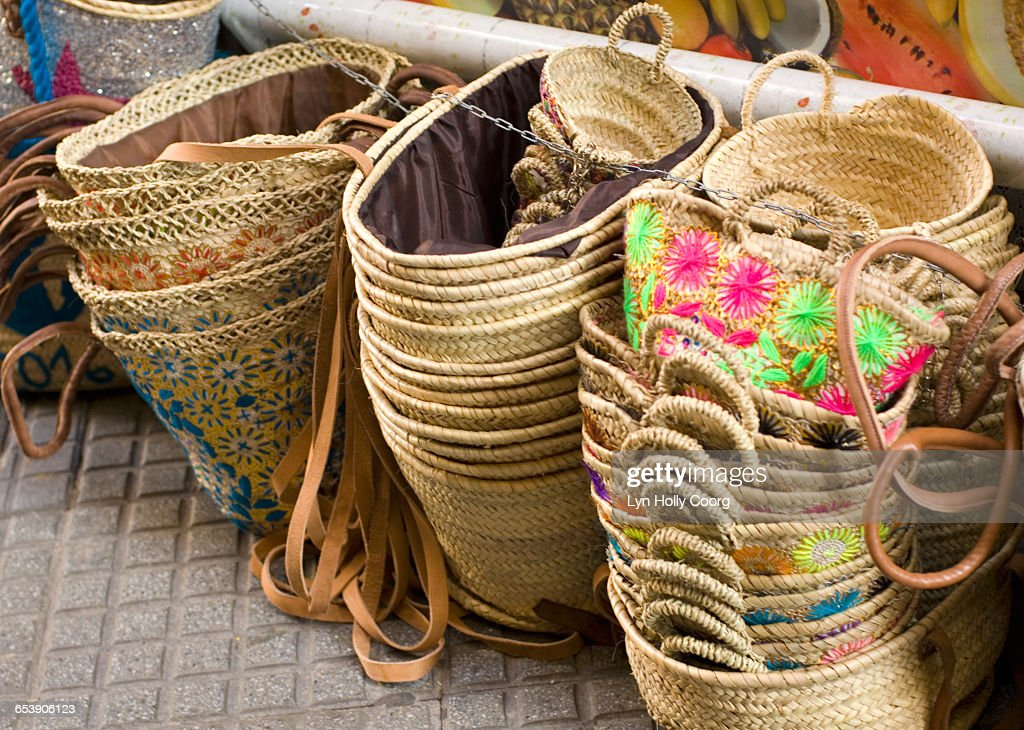 Piles of straw baskets for sale in market : Stock Photo