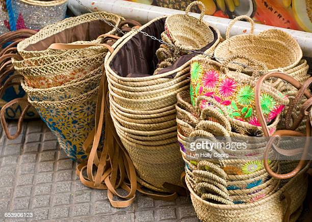 piles of straw baskets for sale in market - lyn holly coorg stock pictures, royalty-free photos & images