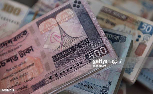 Piles of Taka the currency of Bangladesh are displayed for a photograph in Dhaka Bangladesh on Thursday Jan 25 2007