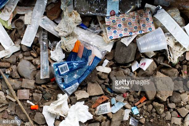 Piles of trash including thousands of syringes and empty heroin bags are found at the heroin camp located under the North Second Street overpass in...