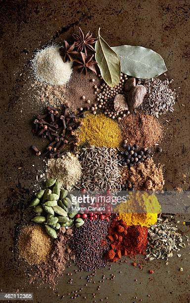 piles of various spices on metal surface - spice stock pictures, royalty-free photos & images