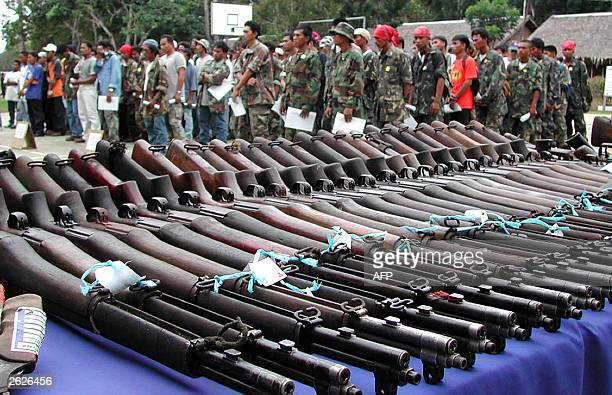 Piles of vintage M1 rifles yielded by 213 rebels from the Moro Islamic Liberation Front and armed followers of jailed former Muslim governor Nur...