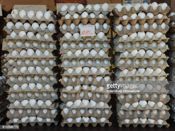 Piles of white eggs stacked in cartons in Cuba