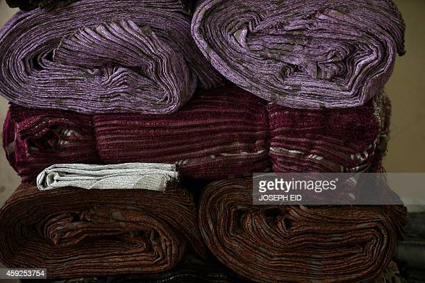 Piles of wrapped cloth are seen at a textile factory in Aleppo's industrial area in the government controlled side of the wartorn northern Syrian...