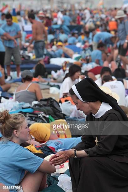 pilgrim and nun at world youth day - nun stock-fotos und bilder