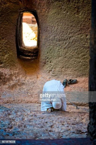Pilgrim at Madhane Alem rock hewn church in Lalibela, Ethiopia