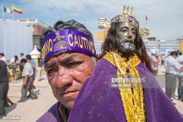 A pilgrim carries a Señor Cautivo de Ayabaca figure in front of the Trujillo Cathedral during Pope Francis 4day apostolic visit to Peru on January 19...