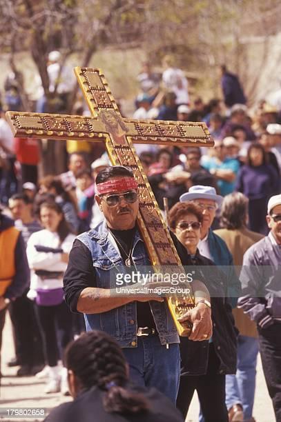 Pilgrim carrying cross Good Friday Pilgrimage El Sanctuario de Chimayo Chimayo New Mexico