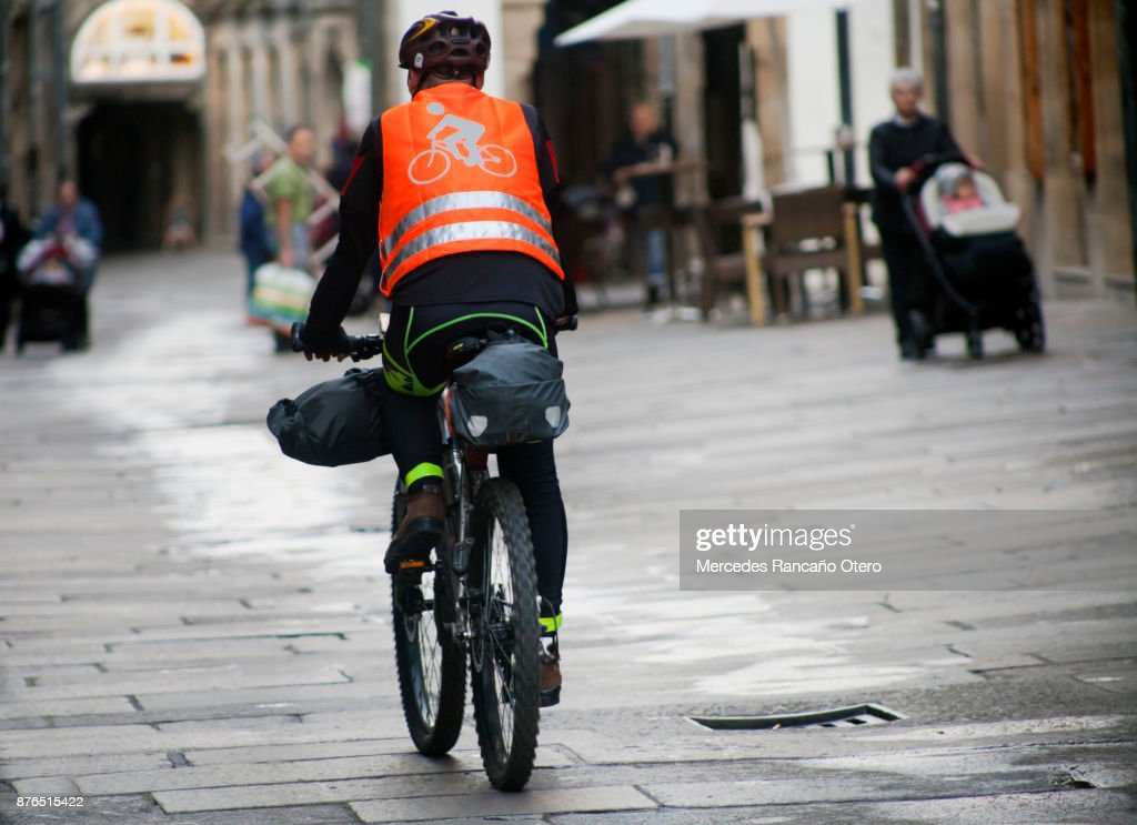 Pilgrim cyclist riding in old town Santiago de Compostela. : Stock Photo