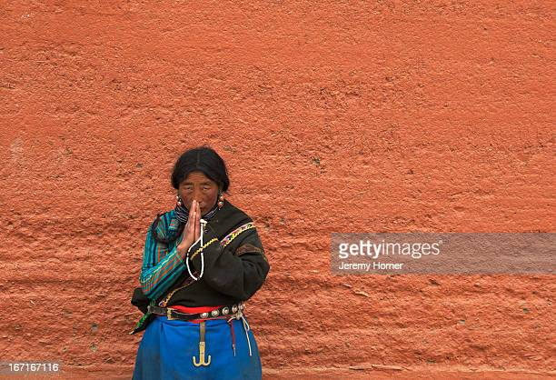 Pilgrim during prayer Labrang Monastery Gansu Province China Labrang Monastery is one of six monasteries of the Geluk school of Tibetan Buddhism...