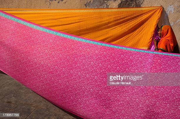 Pilgrim from Maharashtra drying Saris on the Ghats in Dwarka. Gujarat